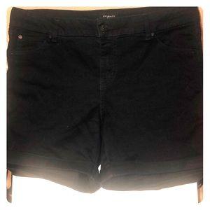 Black mid-thigh shorts